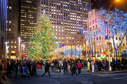 NEW YORK-DEC 5: Crowds gather at Rockefeller Center to see the newly lit Christmas tree on December 5, 2013.